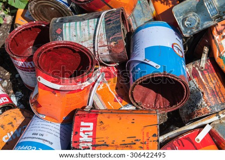 Suratthani,Thailand, August 15,2015:Paint cans old iron broken or expired deterioration after the end of its use at the plant get old to be recycled  - stock photo
