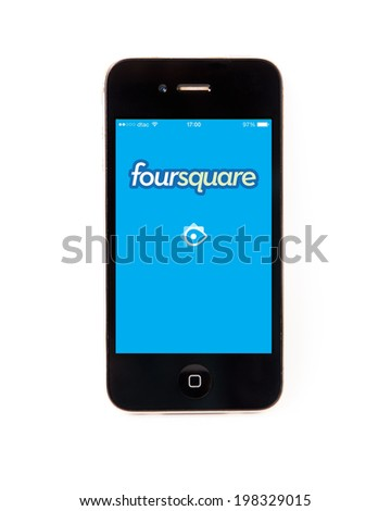 SURATTHANI THAILAND - JUNE 13,2014: Photo of foursquare logo on iphone this application  as social network and gamification.Appearance is a reference site and  Check in. - stock photo