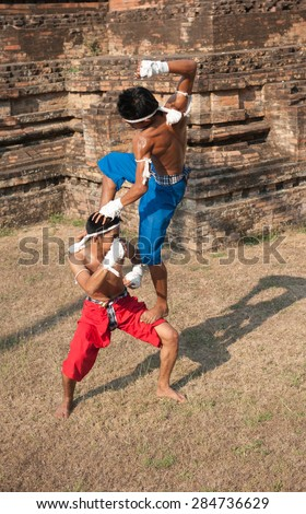 SURATTHANI THAILAND- Mar 9: Two of boxer that showed how to use the muay thai chaiya in real life at Keaw Temple. Mar 9,2014 in surat thani province,Thailand