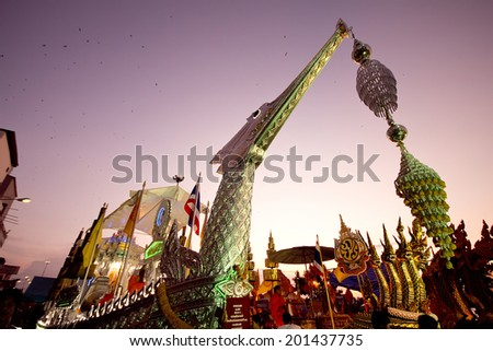 SURATTHANI, THAILAND - OCTOBER 17 : Barge is decorated on parades in Chak Phra Festival on October 17, 2011 in Suratthani, Thailand. Chak Phra is the traditional of buddhist festival in Suratthani. - stock photo