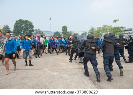 SURATTHANI THAILAND- Sep. 21: Polices practice riot controlling using a shield and a truncheon training tactical differentat police training academy.Sep 21, 2015 in suratthani province,Thailand
