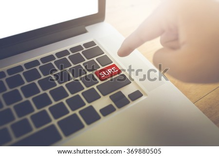 Sure word and Man hand press the button. - stock photo