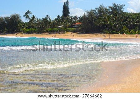 Surf and aquamarine waters of Haena Beach on the north side of Kauai