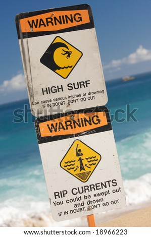 Surf and Currents Warning Sign on a beach in Hawaii - stock photo