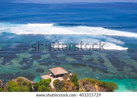 Surf and reef in Uluwatu in Bali - stock photo