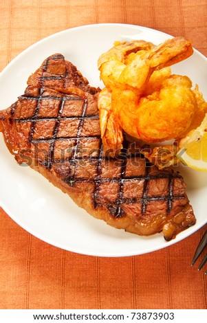 Surf and Turf meal of juicy sirlon steak crispy jumbo shrimp - stock photo