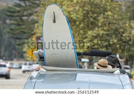 surf board in a vintage car in California - stock photo