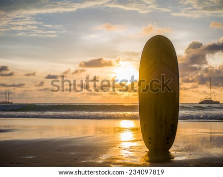 Surf board on the ocean beach at sunset on Bali island, Indonesia - stock photo