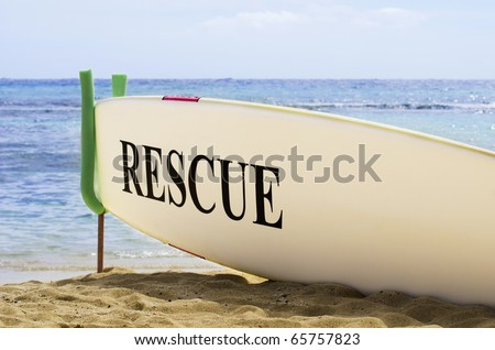 Surf Board Safety Concept on Hawaiian Sandy Beach - stock photo