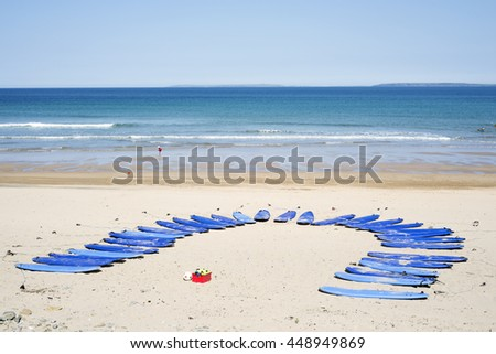 surf boards at surf school on ballybunion beach in county kerry ireland - stock photo