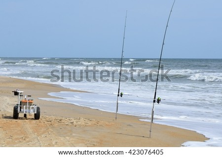 Surf Fishing poles on the beach surf - stock photo