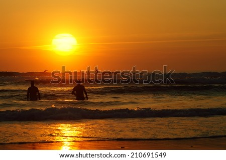 Surf in Lacanau at sunset in august 2013 during the  World Championship Tour