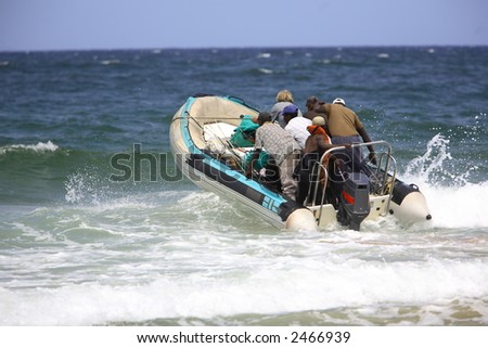 Surf launch of a rubber duck - stock photo