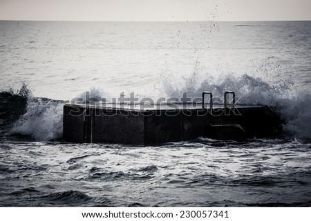 Surf on the pier. Atlantic Ocean - stock photo