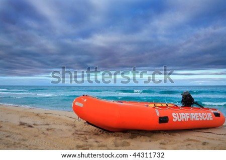 Surf Rescue boat against dramatic sky