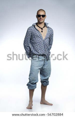 surf style young man - stock photo