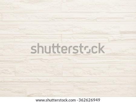 Surface brown wall of stone wall sepia tones for use as background. The new design of modern white stone wall. Pattern of decorative gray stone wall surface. - stock photo