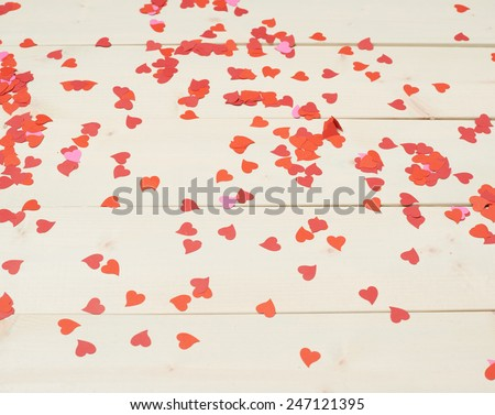 Surface covered with heart shaped confetti as Valentine's Day love background composition - stock photo