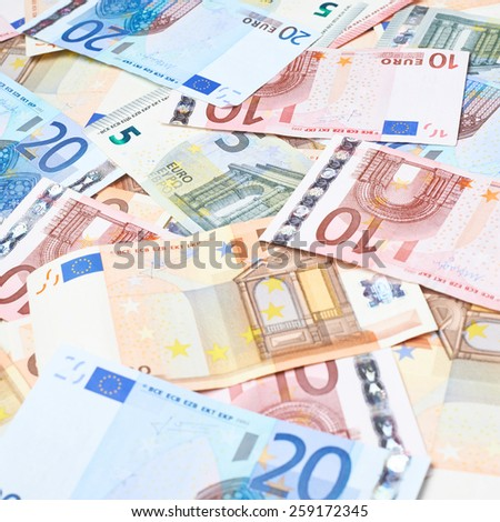 Surface covered with multilpe euro bank note bills as a background composition