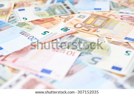 Surface covered with multilpe euro bank note bills as a background composition with the shallow depth of field - stock photo