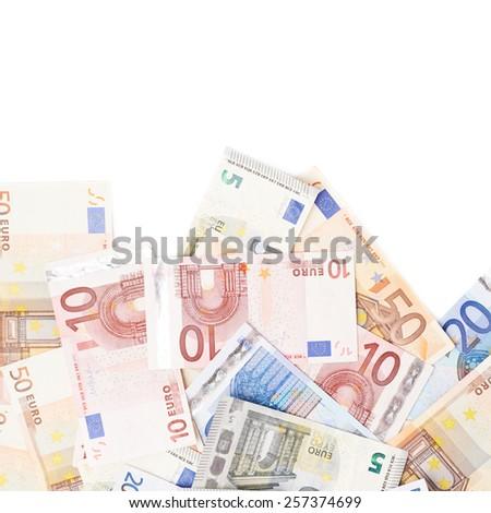 Surface covered with multiple bank note euro bills isolated over the white background - stock photo