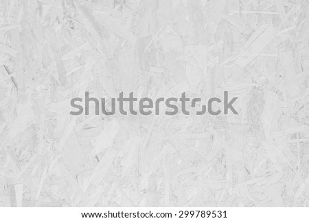 Surface made of pressed wooden shavings as an abstract background, textured background, black and white. - stock photo