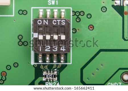 Surface mounted switch on electronic circuit board close-up - stock photo