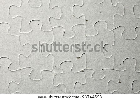 Surface of a grungy paper jigsaw puzzle for textural background. - stock photo