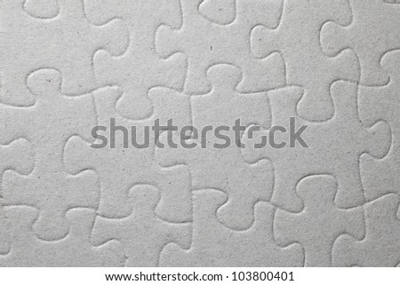 Surface of a paper jigsaw puzzle for textural background. - stock photo