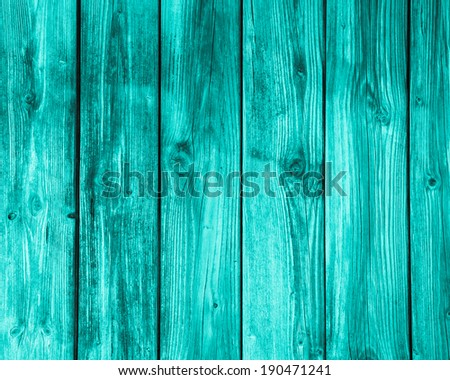 Surface of an empty turquoise wooden background. - stock photo