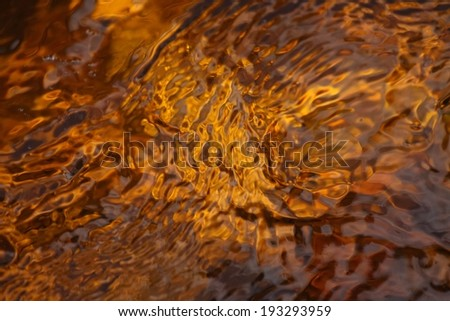 Surface of beautiful river  flowing from moorland - stock photo