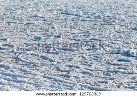 Surface of frozen Baltic sea.