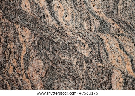 Surface of polished granite slab. Close-up of beautiful natural design of red granite. - stock photo