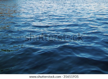 Surface of the sea in natural blue background - stock photo