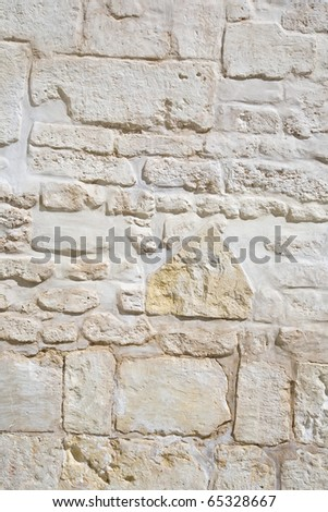 surface of vintage stone wall at old house - stock photo