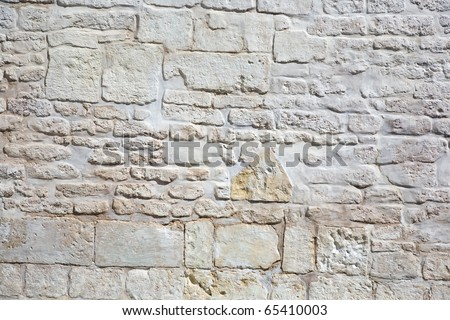 surface of vintage stone wall at old street - stock photo