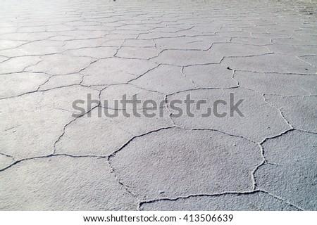 Surface of world's biggest salt plain Salar de Uyuni, Bolivia - stock photo