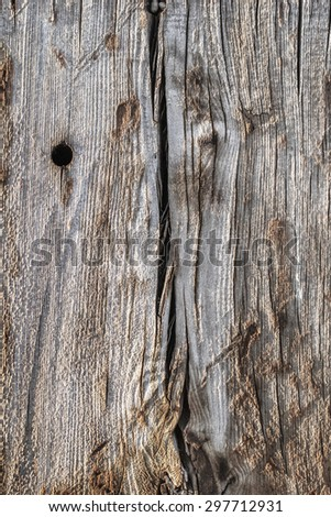 Surface texture of an old weathered, rotten, cracked Square Timber Bollard, made of obsolete, scrapped Railroad Cross Tie Timber. - stock photo
