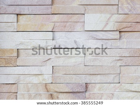 Surface wall of stone wall sepia tones for use as background. The new design of modern stone wall. pattern of decorative stone wall surface.