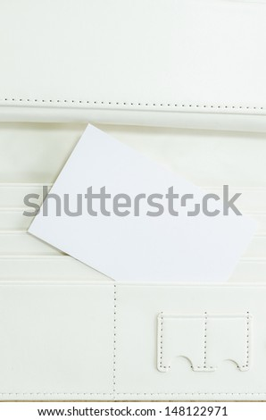 Surface white leather wallet with note - stock photo