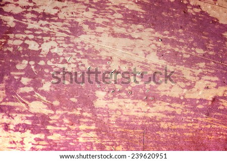Surface with discolored pink paint flaking and cracking background texture  - stock photo