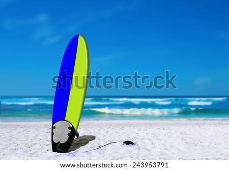 Surfboard on Sand at Beach - stock photo