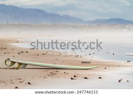 surfboard on the beach - stock photo