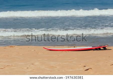 Surfboard on the Sand - stock photo