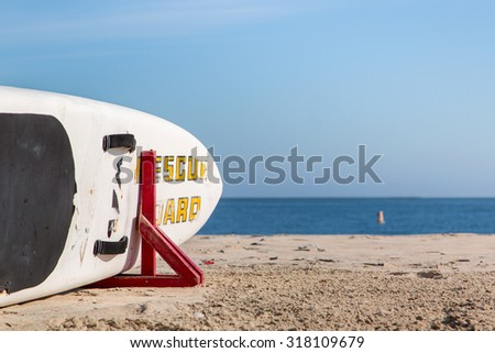 Surfboard ready for a rescue on the beach in Long Beach, Los Angeles - stock photo