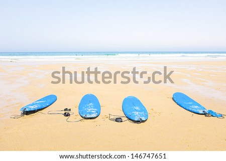 Surfboards at the beach in Portugal - stock photo