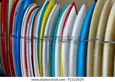 Surfboards standing on a display in a surf shop, Tenerife, Spain.