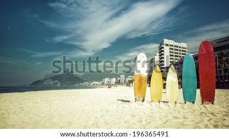 Surfboards standing upright in bright sun on the beach at Ipanema, Rio de Janeiro Brazil - stock photo