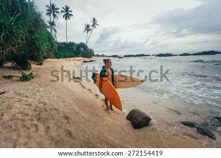 Surfer after surfing - stock photo