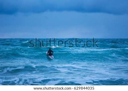 Surfer are training on the Skagsanden beach of the Lofoten Islands